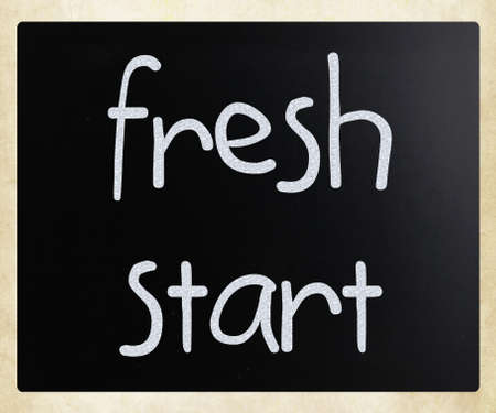 fresh start  handwritten with white chalk on a blackboard photo