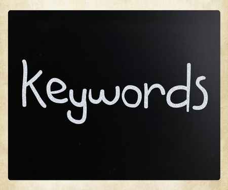 The word  Keywords  handwritten with white chalk on a blackboard Stock Photo - 12816329
