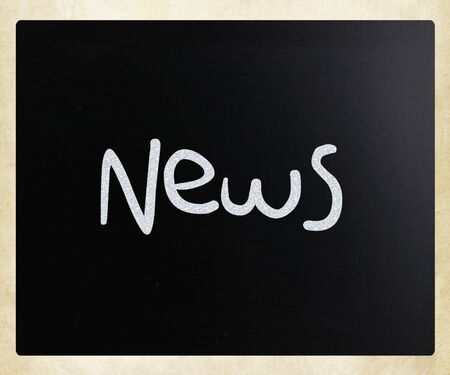 News  handwritten with white chalk on a blackboard Stock Photo