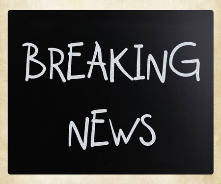Breaking news  handwritten with white chalk on a blackboard Stock Photo - 12816136