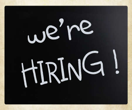 We are hiring   handwritten with white chalk on a blackboard photo