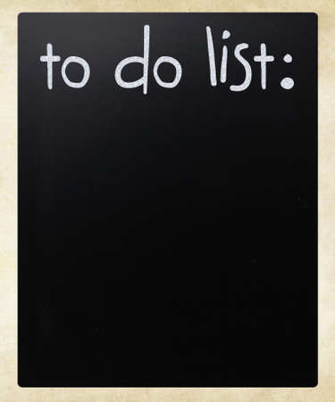 To do list  handwritten with white chalk on a blackboard Stock Photo - 12816139