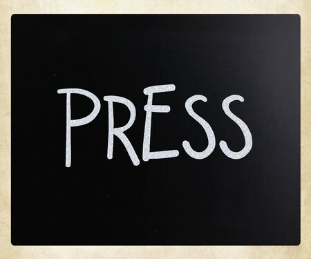 PRESS  handwritten with white chalk on a blackboard Stock Photo - 12816148