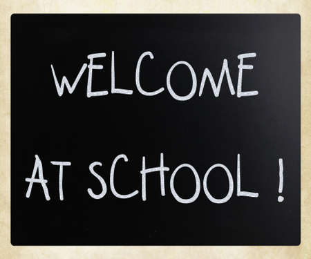 photorealistic:  Welcome at school  handwritten with white chalk on a blackboard