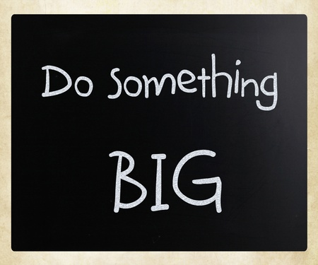Do something big handwritten with white chalk on a blackboard photo