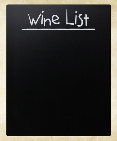 Wine list handwritten with white chalk on a blackboard photo