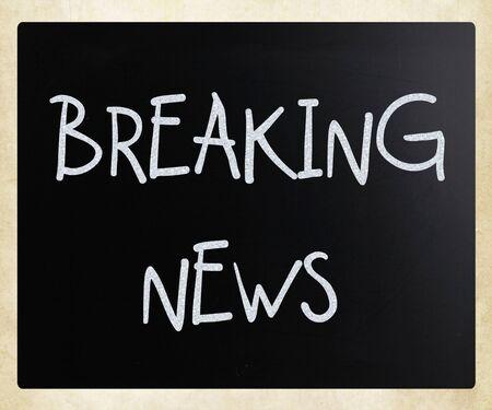 breaking news: Breaking news handwritten with white chalk on a blackboard Stock Photo