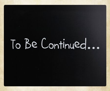 continued: To be continued handwritten with white chalk on a blackboard Stock Photo