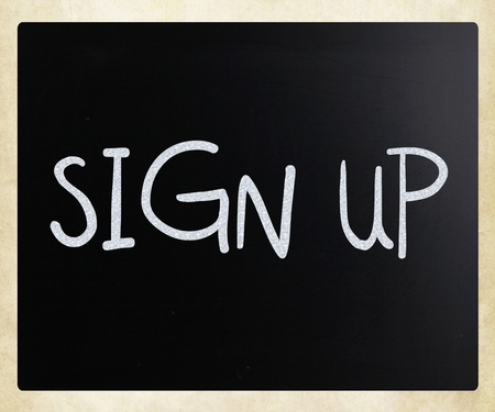 Sign up handwritten with white chalk on a blackboard photo