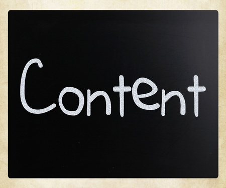 The word Content handwritten with white chalk on a blackboard photo