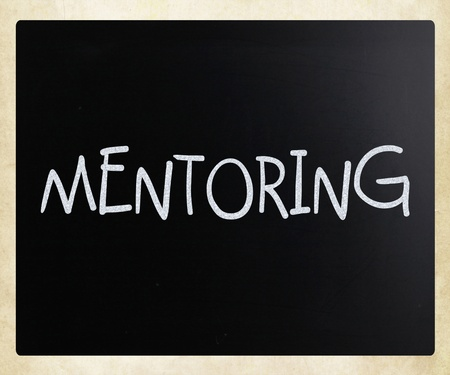 perceived: Mentoring handwritten with white chalk on a blackboard