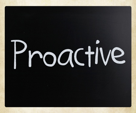 The word 'Proactive' handwritten with white chalk on a blackboard Stock Photo - 12828126