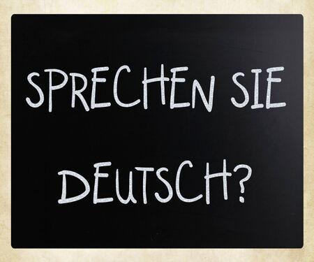 Sprechen Sie Deutsch? handwritten with white chalk on a blackboard photo