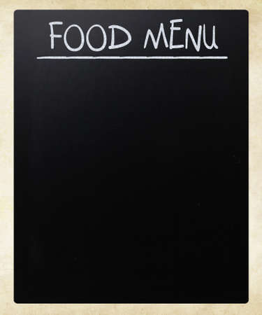 Food menu handwritten with white chalk on a blackboard photo