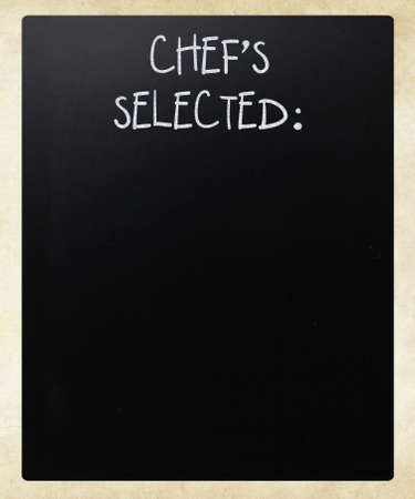 Chefs Selected handwritten with white chalk on a blackboard photo