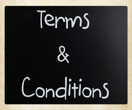 Terms & Conditions handwritten with white chalk on a blackboard photo