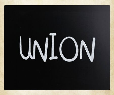 The word Union handwritten with white chalk on a blackboard Stock Photo
