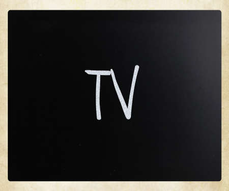 TV handwritten with white chalk on a blackboard photo