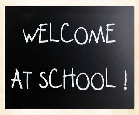 Welcome at school handwritten with white chalk on a blackboard photo