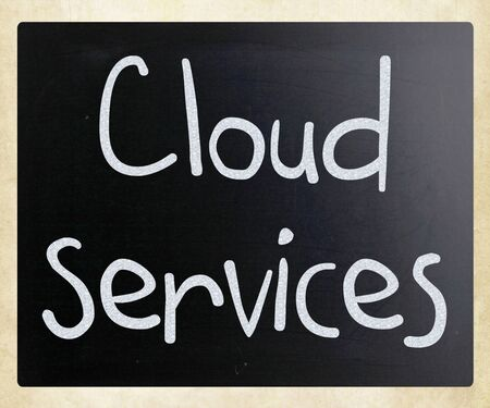 Cloud services handwritten with white chalk on a blackboard photo