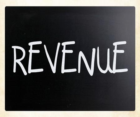 Revenue handwritten with white chalk on a blackboard photo