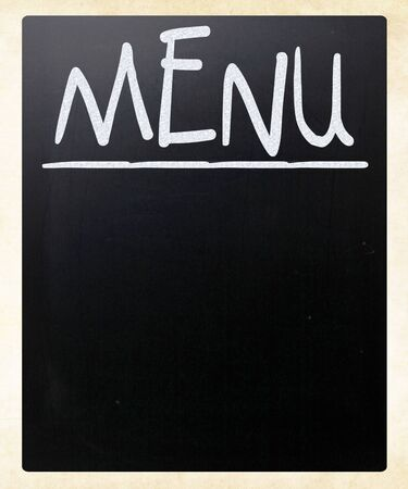 Blank blackboard with white chalk smudges used a restaurant menu. photo