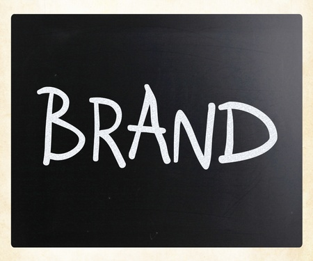 Brand handwritten with white chalk on a blackboard photo