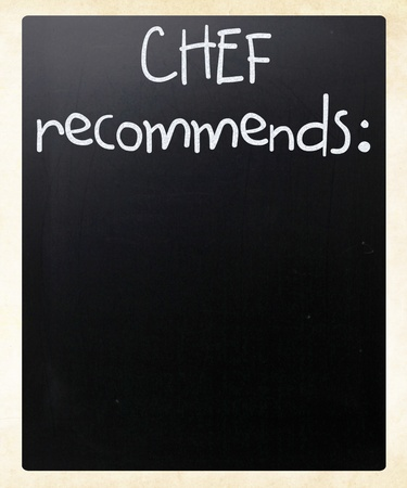 Chef recommends handwritten with white chalk on a blackboard photo