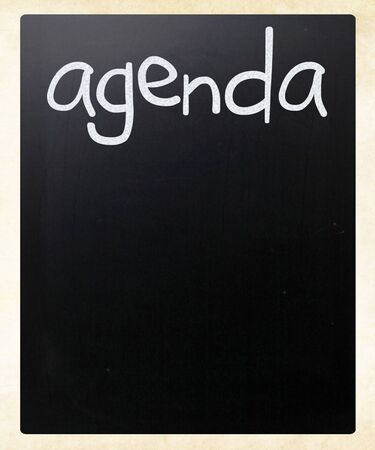 AGENDA handwritten with white chalk on a blackboard photo