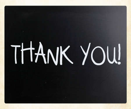 acknowledgment: Thank you handwritten with white chalk on a blackboard