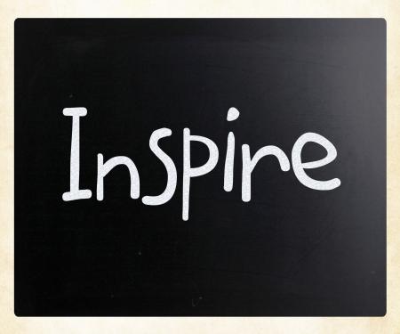 Inspire handwritten with white chalk on a blackboard photo