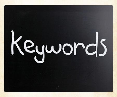 The word Keywords handwritten with white chalk on a blackboard photo