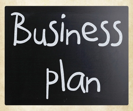 Business plan handwritten with white chalk on a blackboard photo
