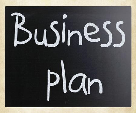Business plan handwritten with white chalk on a blackboard photo