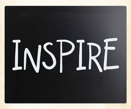 'Inspire' handwritten with white chalk on a blackboard photo