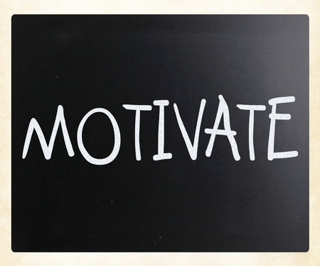 Motivate handwritten with white chalk on a blackboard photo