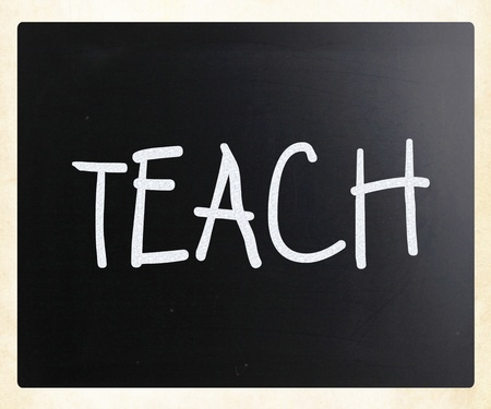Teach handwritten with white chalk on a blackboard photo