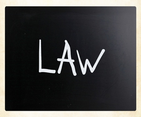 The word Law handwritten with white chalk on a blackboard photo