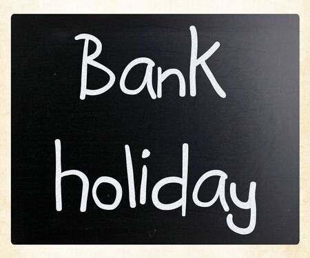 Bank holiday handwritten with white chalk on a blackboard photo