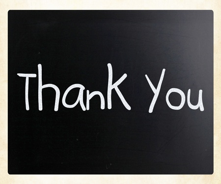grateful: Thank you handwritten with white chalk on a blackboard