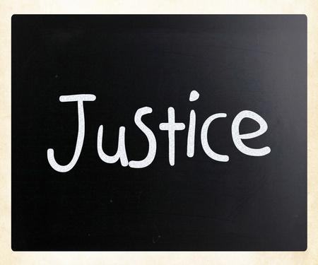 Justice handwritten with white chalk on a blackboard photo
