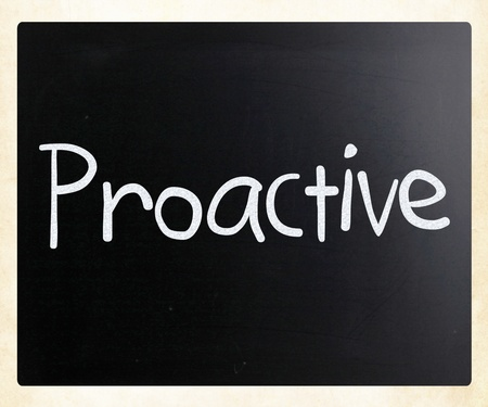 The word Proactive handwritten with white chalk on a blackboard photo