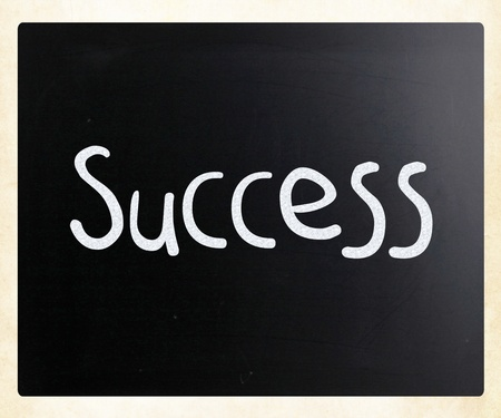 The word 'Success' handwritten with white chalk on a blackboard Stock Photo - 13124415