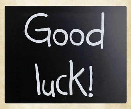Good luck! handwritten with white chalk on a blackboard photo