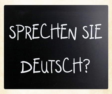 Sprechen Sie Deutsch? handwritten with white chalk on a blackboard photo