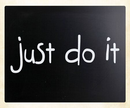 Just Do It handwritten with white chalk on a blackboard photo