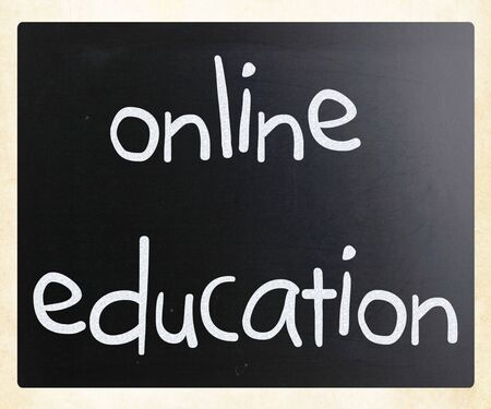 'Online education' handwritten with white chalk on a blackboard photo