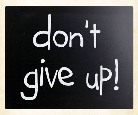 Dont give up handwritten with white chalk on a blackboard photo