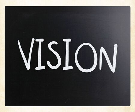 Vision handwritten with white chalk on a blackboard photo
