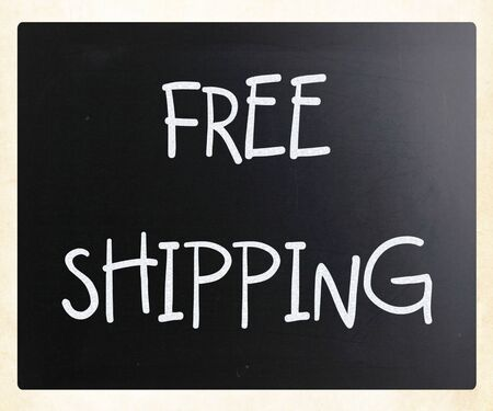 Free shipping handwritten with white chalk on a blackboard photo